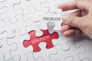 stock-photo-hand-holding-piece-of-jigsaw-puzzle-with-word-problem-solution-548561134